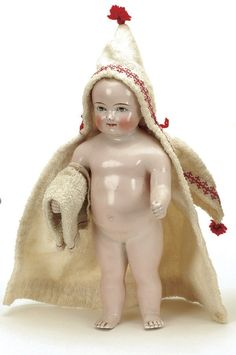 "Germany, ca. 1880, one piece pink luster body with blonde molded and painted brush stroked hair, blue painted eyes, nicely sculpted torso with clenched fists, wearing a terry bathrobe trimmed in red while holding a bath towel. Size: 11.5"" t."