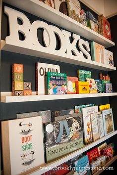 Wall of book's in baby's nursery.. I so want to do this with all the books i got from my shower!!!  <3