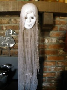 The easiest, but very creepy, Halloween prop EVER! Blank white mask, cheesecloth. We left this hanging for the pic & forgot it.....scared the crap out of us during the night! Very effective. Planning on hanging several of these in the trees. (HF member punkineater)