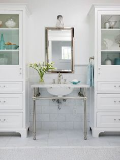 This console sink vanity is flanked with furniture-style cabinets. More bathroom vanity ideas: http://www.bhg.com/bathroom/vanities/bathroom-vanity-ideas/