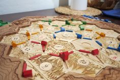 This guy is brilliant. Settlers of Catan board with etched in spaces for numbers, roads, and settlements. Wall Mountable Board Game Design for CNC Mill