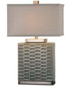 Bring a fashionable element to your space with the handmade Virelles Ceramic table lamp from Uttermost. A beautiful embossed pattern of repeating oblong shapes is finished in a neutral glaze and topped with an oversize rectangular shade. Ceramic Table Lamps, Space Furniture, Fabric Shades, Lamp Light, Baby Shop, Light Fixtures, Bulb, Ceramics, Lighting