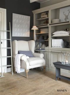 Woonmagazine.  I want this look in my family room.  Remove the other bookcase, put in a cozy chair and lamp.