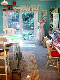 Like the curtain above the window and the manequin with the dress/apron and the desk off to the right... I just love this room~!~