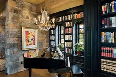 """In-home library featuring black shelving and baby grand piano. Builder: Schlauch Bottcher Construction Interior Design: <a href=""""http://www.locatiarchitects.com/"""">Locati Interiors</a> Photography: <a href=""""http://www.rogerwadestudio.com/"""">© Roger Wade Studio</a>"""