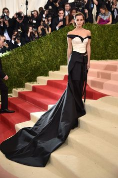 Regal - off-the-shoulder top pants suit worn by Emma Watson at this years 2016 - Met Gala Charity event. Sophisticated look.   #redcarpet #celebrity #uniqueoutfit #blackwhite #pantssuit #bridesmaids ideas.  #discreettiger  www.discreettiger.com.au