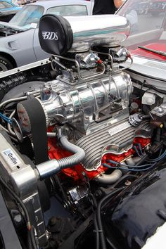 Supercharged Chevy 409 base on the 348 chevy , first year for this engine was 1961