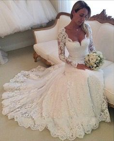 Sweetheart neckline Lace appliques along entire sleeve and dress Floor Length Court train Mock buttons along inside of forearm Sheath dress