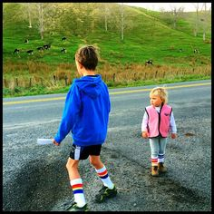 Wearing their Pride Socks whilst waiting for the school bus.