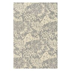 Elegantly anchor your parlor or dining room with this eye-catching rug, showcasing a nature-inspired motif in grey and ivory.   Product:...