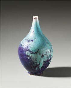 PHILLIPS : UK050312, TOINI MUONA, Vase 1948 TOINI MUONA  Vase, circa 1948   Porcelain, glaze.  34 cm (13 3/8 in) high  Produced in Arabia, Finland. Underside incised with artist's mark. Estimate £6,000 - 8,000   ♠  Sold for £6,875