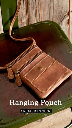 A reissue of an iconic Roots style, our Hanging Pouch is versatile and timeless. Designed and handcrafted in Canada, it features two front zipper pockets and one front pocket with a snap closure on the flap. Roots, Pouch, Canada, Closure, Zipper, Pockets, Leather, Bags, Accessories