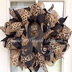 Popular burlap wreath with leopard, polka dot, swirly, and chevron print burlap ribbons and single vine script letter  Jayne's wreath designs on fb and Instagram. Home decor. Decorating.