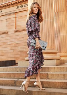 A floral dress paired with an embellished clutch is perfect for a special event. And as for this fishtail hem? We're in love.