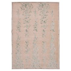 Tufted floral rug.  Product: RugConstruction Material: Viscose and chenilleColor: Ivory and blue...