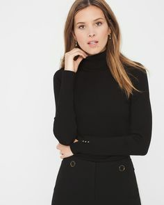 """Tiny-yet-impactful studs grace the cuffs of our chic black turtleneck with a pointelle center detail. Stylist Note: Take the monotone trend to the office by wearing it with our black seasonless pants. Pointelle-detail turtleneck Nylon/rayon. Machine wash. Approx. 24.5"""" from shoulder Imported"""
