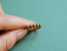 tiny skulls ring