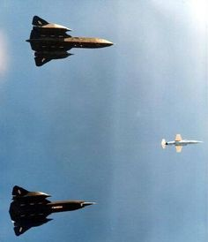 An SR-71 and a YF-12A inflight together with a F-104.
