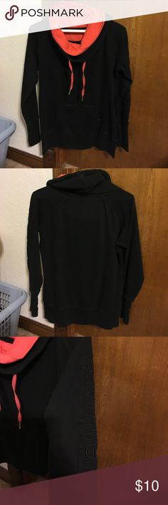 Calvin Klein performance sweatshirt Worn and washed many times but still very wearable. Good used condition. No holes, stains, etc. Nice and cozy. 60% cotton 40% polyester. Colors: black and coral. Calvin Klein Tops Sweatshirts & Hoodies