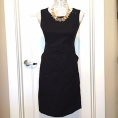 Perfect Little Black Dress  The perfect little black dress!  Size 2. Sleeveless dress, zipper back, two front pockets and button detail on shoulder.  Dress is lined and machine washable!  Excellent condition, only wore 1-2 times.  Purchased at Banana Republic Factory store.  Length measured from back of dress from top to bottom is 34 inches, from bottom of arm pit to bottom of dress is approx 27 inches.  Arm pit to pit approx 18 inches. Banana Republic Dresses Midi