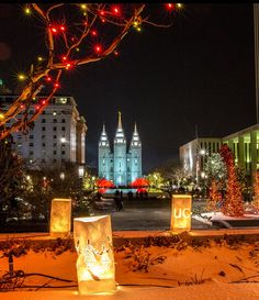 Luminaries near Temple Square in Salt Lake City. Christmas celebrations are a beautiful experience each December. Temple Square, National Treasure, Salt Lake City, Places To See, Utah, Celebrations, National Parks, December, Christmas