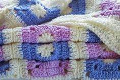 Crocheted patchwork throw, folded up - Ruth Jenkinson / Getty Images