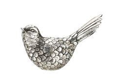 Silver objects add interest and glamour. Sit this intricate little bird on a mirrored table for full effect. Priced at £6.