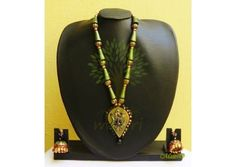 Handmade Terracotta Jewelry - Terracotta Exclusive Grand Set  An Earthy pendant set in a beautiful design, handmade using river bed clay called terracotta, fired and hand painted with great care. A natural form of heritage Indian art jewelry, painted in e