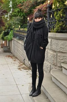 snuggle up. black jeggings, black coat, big cozy sweater.