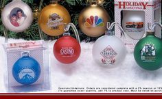 """Custom Glass Ornament - OUC-02     Custom glass ornament. This beautiful glass Christmas ornament is a perfect keepsake imprinted with your special design. Each ornament is individually gift boxed for easy display all year long. Most designs can be pad printed with one to four spot colors, or four color process on one or two sides. 3 1/4"""" ornament box.  www.logosurfing.com (800) 728-7192"""