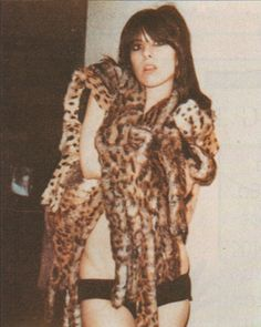 Chrissie Hynde of the Pretenders in a bizarre photo in her underwear with animal furs. Chrissie Hynde, The Pretenders, Women Of Rock, Into The Fire, Rock Chick, Celebs, Celebrities, Rock Music, Refashion