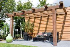 A van Spelde Hoveniers: Moderne Tuinhuizen Overkappingen