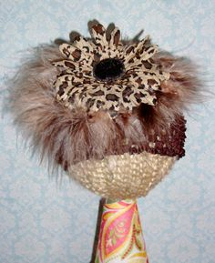 Fabulous brown waffle hat with leopard print flower and feather embellishment.