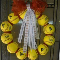 Softball wreath I made with custom 'softball chants' on ribbon that I printed. It's for a raffle...and i think it looks AWESOME!!  I hope it brings in good money for our team. #craft #softball