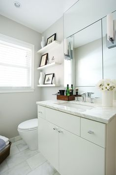 Contemporary Full Bathroom with European Cabinets, Jeffrey Court Carrara 8 in. x 12 in. Honed Marble Floor and Wall Tile. Nice clean look without coming across as stark.