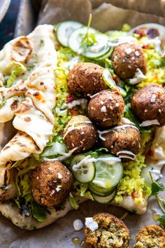 Falafel Naan Wraps with Golden Rice and Special Sauce (vegetables, chickpeas, pitas or naan) Falafels, Veggie Yogurt, Golden Rice, Falafel Wrap, Naan Recipe, Falafel Recipe, Half Baked Harvest, Vegetarian Recipes, Vegetarian Burgers