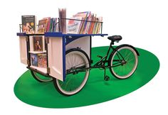 The Book Bike, a gift from the FRIENDS of the Heights Libraries, makes appearances at festivals, parades and school events in the community, giving away free donated books and canceled library book...