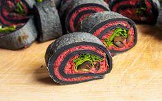 Roasted beet hummus, black olives, and arugula salad tucked into homemade bamboo charcoal tortillas.