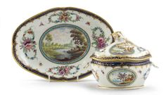 A Worcester sauce tureen with cover and stand c.1780-85, painted in the Dalhousie manner with oval panels of river scenes, lakeside views and ruins in landscapes, within floral garland arrangements and with scattered moths and other insects, the rims with blue and gilt borders, open crescent marks, 24cm. (3)