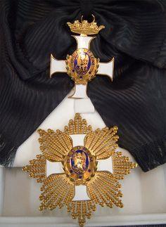 Gran Cruz y Banda de la Orden de San Miguel el Taumaturgo.