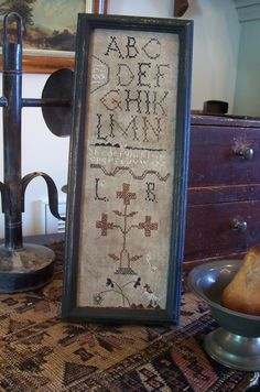 Stitched by The Primitive Stitcher.. Long narrow school girl sampler..simple and sweet.