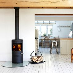 Want a wood burner in the new kitchen/diner Log Burner Fireplace, Wood Burner, Log Burner Living Room, Hanging Fireplace, Black Fireplace, Modern Log Burners, Small Log Burner, Corner Log Burner, Range Buche