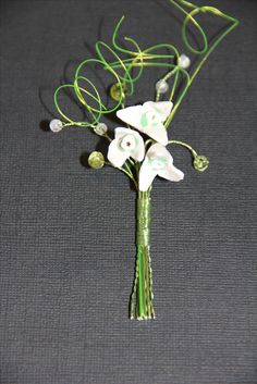 Polymer clay snowdrops, faceted peridot rondelles and clear crackled quartz button hole