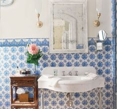 In a Michael Smith bathroom, blue- and-white tiles are a richer version of wainscoting.