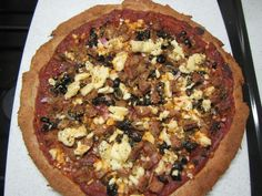 """Seasoned pizza crust with sausage, black olives and feta cheese. From """"The Gluten-Free Gourmet Bakes Bread"""""""