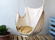 simple-diy-ceiling-hanging-chair-from-white-fabric