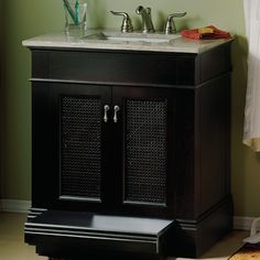 We love the rattan doors. And the slide-out step is great for helping the little ones reach the sink. || American Standard Generations Vanity Cabinet in Dark Chocolate