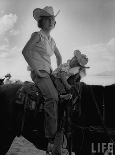 Awesome mother-daughter portrait from Life Magazine in 1955. Read more about their story here: http://quitecontinental.net/2011/05/24/life-archives-the-youngest-cowgirl-1955/