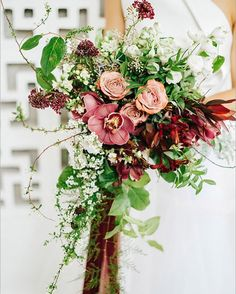 organic & wild cascading bouquet with cymbidium orchids & cappuccino roses