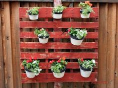 attach metal brackets pallet fix stable wall fence pallet falling